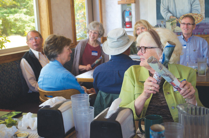 Eleanor Lee sings along with the group gathered at Ferino's Pizza on June 27 for the one-year anniversary of the Memory Cafe.