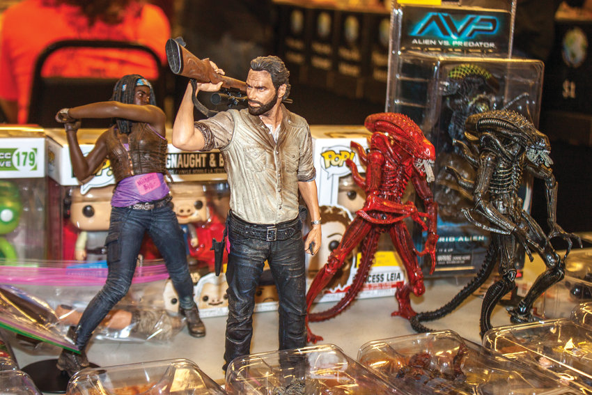 """Comic Book Swap Meet in Chimacum included action figures such as Rick Grimes and Michonne of """"The Walking Dead"""" facing off against a pair of Xenomorphs from the """"Aliens."""""""