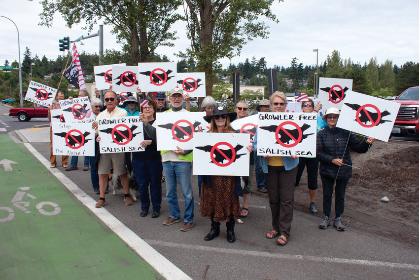 Nearly two dozen protesters of the proposed Growler operation expansion at Whidbey Island turned out to protest in Port Townsend July 13.