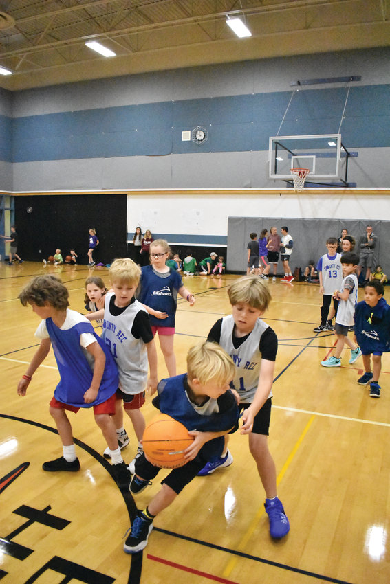 Claire Harrison, Riley Avery, Halsey Emery, Zane Nichols, Pierce Edgar and William Petta compete in a tournament on the last day of basketball camp, which was hosted by the Jefferson County Parks and Recreation.
