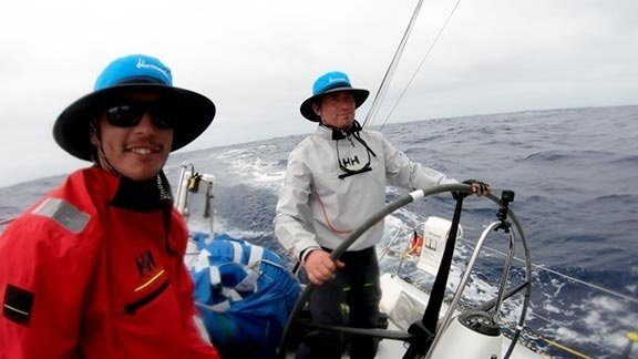 Matt Pistay, right, of Port Ludlow on deck during Team Hamachi's bid to win the 2019 Transpacific Yacht Race.