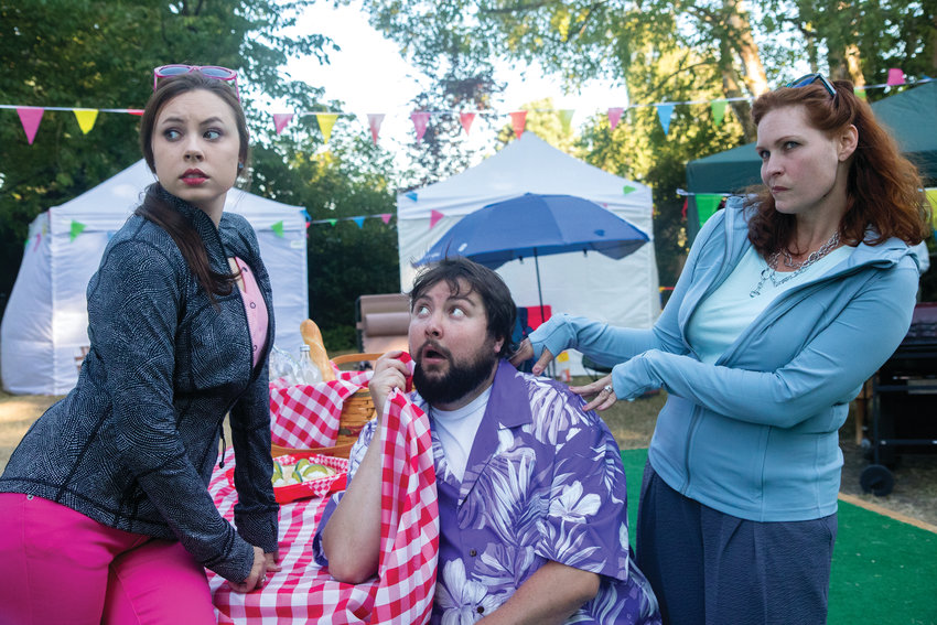 Key City Public Theatre's Brendan Chambers plays the buffoonish Sir John Falstaff, surrounded by the tricky wives he is hoping to seduce for their money, played by Krista Curry (left) and Crystal Eisele (right).