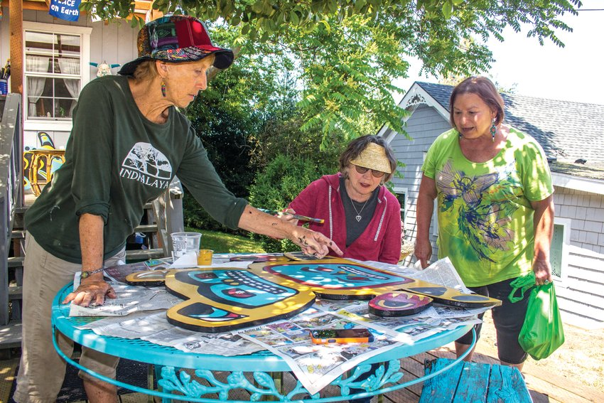 From left, Kimberly Fairbanks, Mary Wilson and Amanda Adams have been working hard to restore a dozen pieces of student art that have been worn down by time and weather.