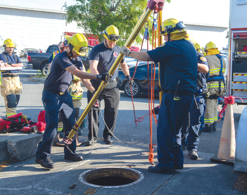 """During annual """"Citadel Rumble"""" disaster preparedness training, Sept. 5, 2018, Firefighters from Naval Air Station (NAS) Whidbey Island's Federal Fire and Emergency Services Department set up a rescue tripod to practice gaining access to an injured person in a confined space. Citadel Rumble is a Navy-wide earthquake and natural disaster drill."""