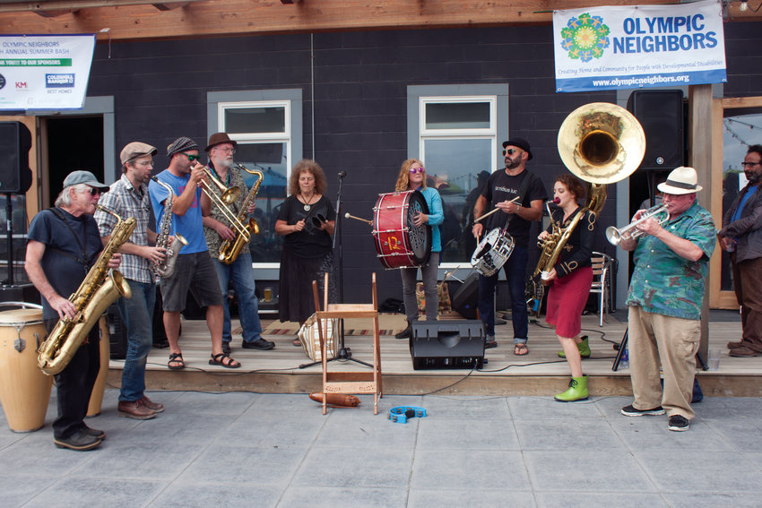 The Unexpected Brass Band makes a joyful noise at the Pourhouse for Olympic Neighbors Aug. 18.