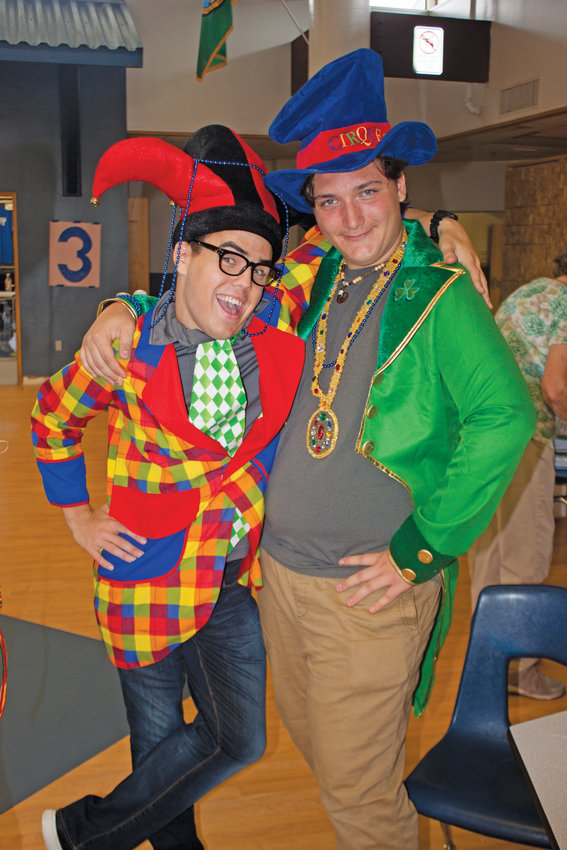 From left, incoming junior Evan Hall and incoming sophomore Andrew Harding help promote the school's drama club.