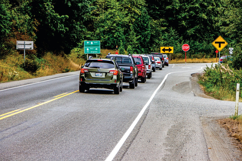 Labor Day Weekend traffic at the intersection of Beaver Valley Road and state Route 104 varied from a half-dozen cars to dozens on Sunday as tourists and locals dealt with bursts of traffic along the main road that were the residue of traffic jams at the eastern approach to the Hood Canal Floating Bridge.