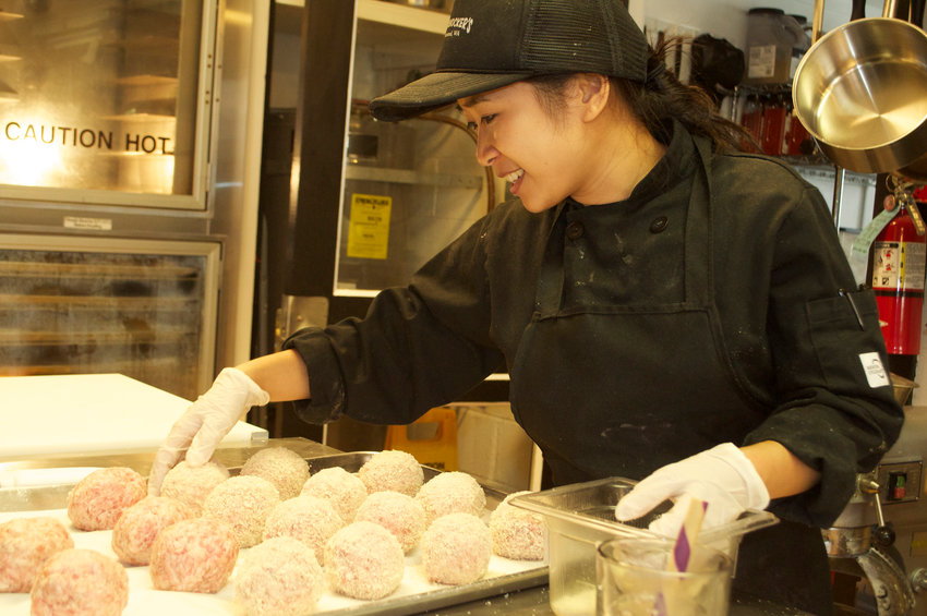 Nikki Skipper, co-owner and head chef at Tommyknocker's Cornish Pasty on Water Street, prepares minced pork for the new eatery's scotch egg dish.