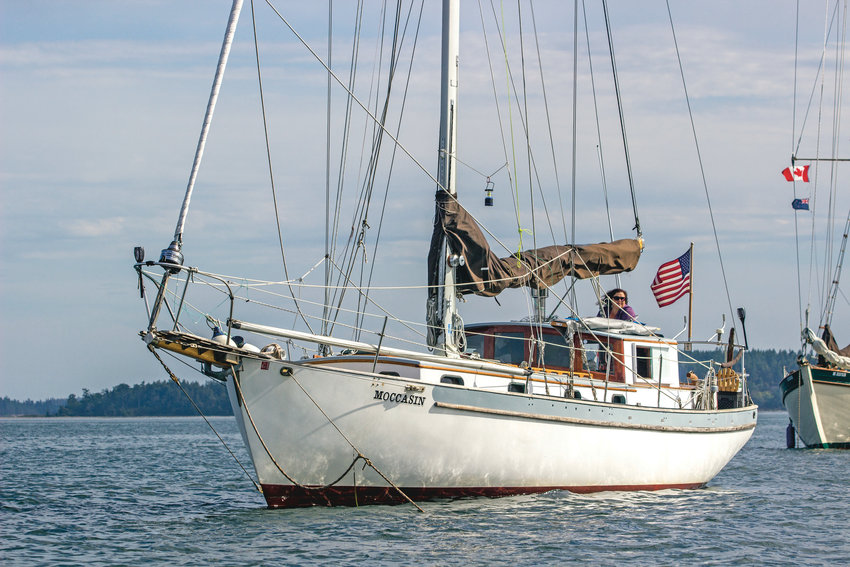 Moccasin was custom built as a salmon troller for a former mayor of Sitka, Alaska, says Peter Bailey, and was launched in 1977. Heidi Snyder can be seen in the aft of the boat, which is at anchor in Port Townsend Bay while undergoing upgrades.