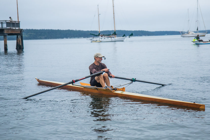 Rower Steve Chapin comes back to the Northwest Maritime Center beach in his Pocock single, placing second in the overall race.