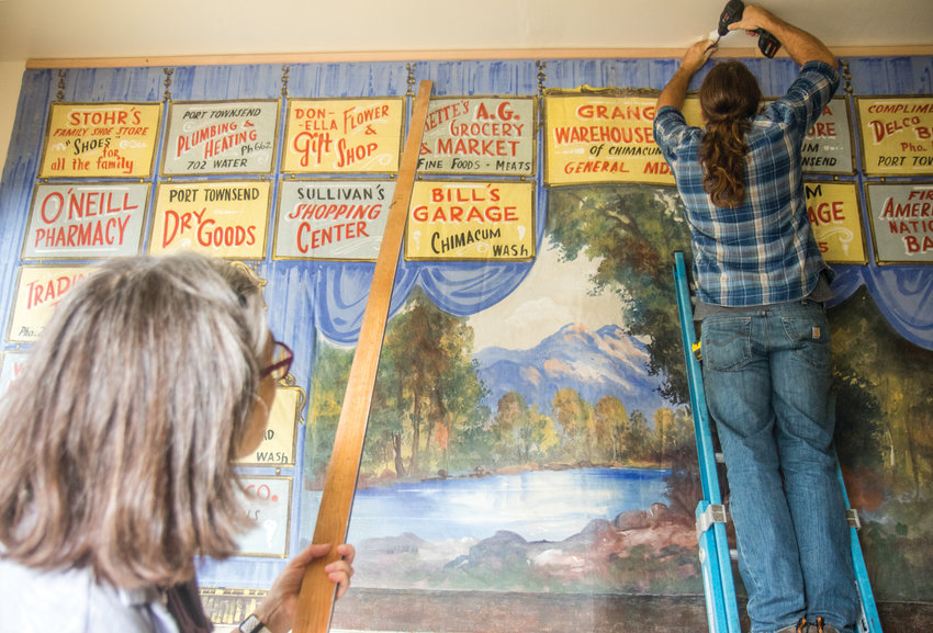 Katy McCoy, left, who has a history in fine art, restored the curtain to hang up at the Grange. It's grand reveal will take place at the 2nd annual Pancake Feed on Sept. 22.