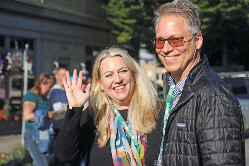 "Cheryl Strayed, author of the memoir ""Wild,"" left, is seen here Friday, Sept. 20 with her husband Brian Lindstrom."