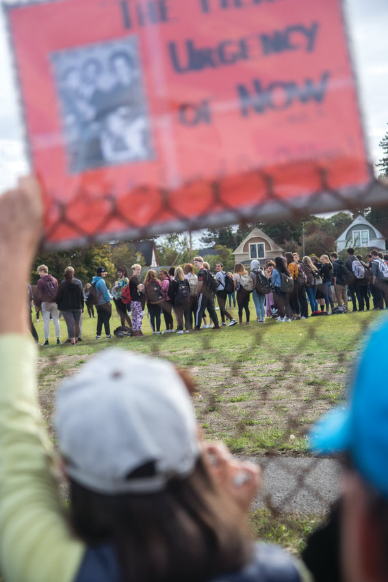 """Do you care?"" asked students of adults who gathered outside of the Port Townsend High School fence. The students' climate strike was organize be kids only, but dozens of Port Townsend residents showed up in support."
