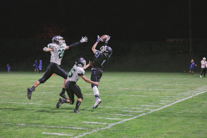 Clayton Smith, wide receiver for the Chimacum Cowboys, plucks this ball out of the heavens to complete a forty yard pass in the third quarter. The Cowboys take the lead in the following play with another pass to Clayton Smith wide open in the endzone.
