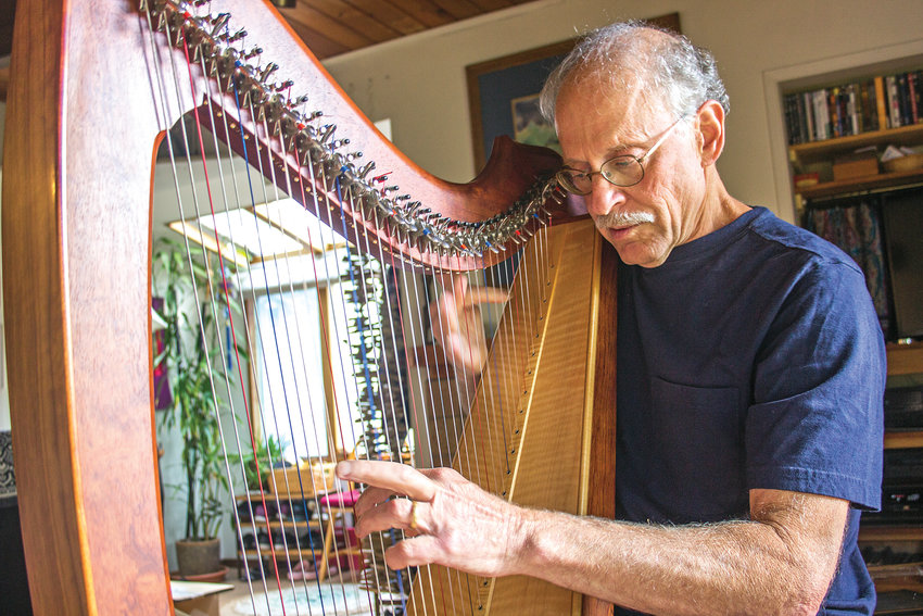 Michael David prefers a Celtic harp over a grand concert harp because he believes the tone from a Celtic harp is warmer and more pure. He said the resonance is loud enough to fill an entire concert hall without use of amplification, although he does have that option if needed.