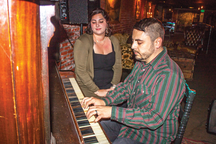 Dominic and Stephanie Svornich marked their last night in business as co-owners of the Cellar Door with a bittersweet tune of farewell on their upright piano.