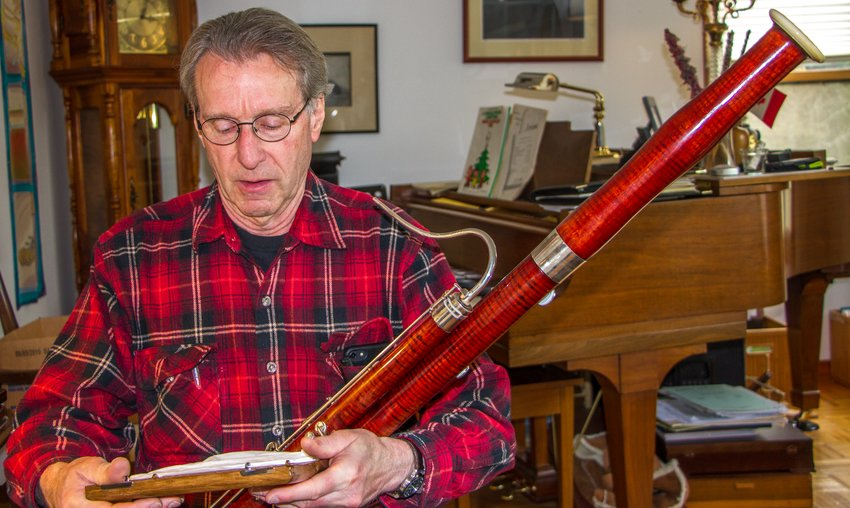 Dave Krabill performs on a vintage Heckel bassoon made in 1928. He practices for at least a couple of hours each day. Leader photo by Chris McDaniel
