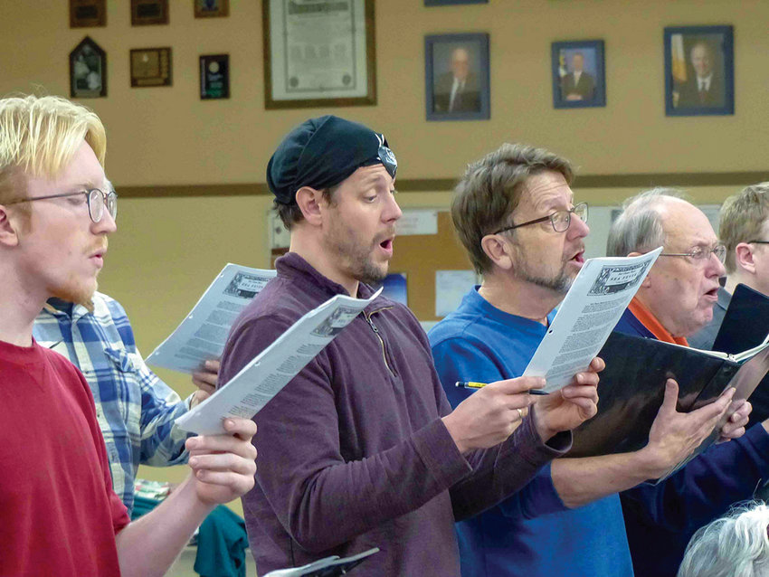 """RainShadow Chorale members rehearse for their upcoming performance with guest composer and conductor Jake Runestad. The chorale will be performing """"The Secret of the Sea,"""" an 11-minute piece written for a string quartet, piano and percussion."""