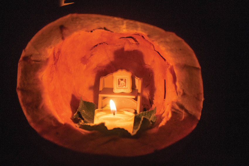 Sunfield School's magical pumpkin village holds a host of tiny homes intricately carved out of squashes.