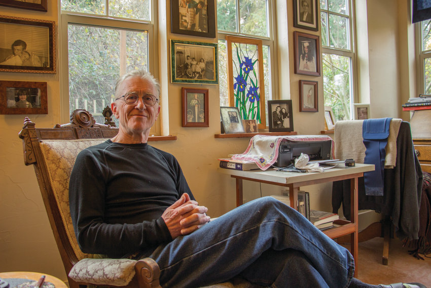 """Curtis White, local author of """"LIVING IN A WORLD THAT CAN'T BE FIXED: Reimagining Counterculture Today,"""" said he first likes to do all his writing by hand in this antique chair, before transferring his thoughts to a digital medium."""