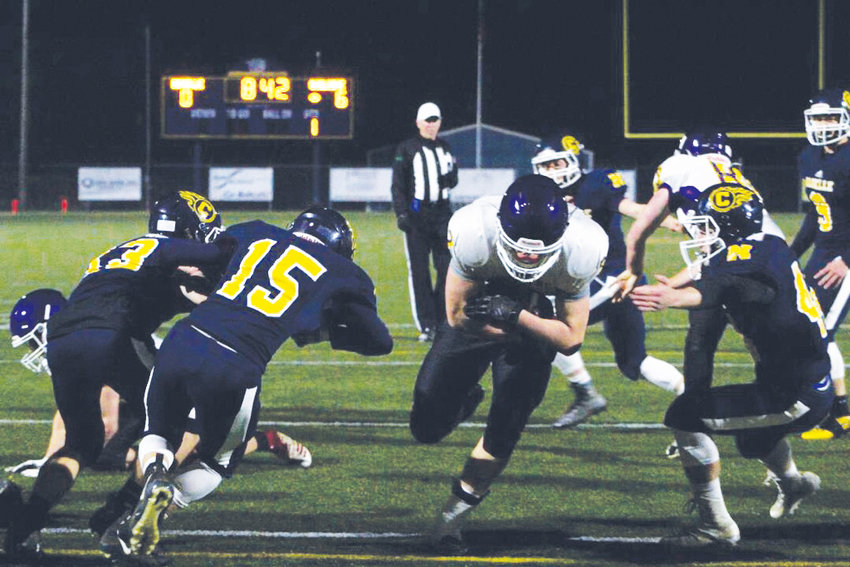 Quilcene running back Bishop Budnek darts through a hole his offensive line created in the Naselle defense.