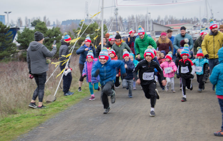 It was 40 degrees out and blowing a gale at 9 a.m. on Saturday Nov. 23 at the Jumping Mouse Turkey Trot 5k and fun run. Nicolas Harper, runner number 274, won the kids one mile fun-run for the second year in a row. Seven-year-old Harper ran an 8:26 mile beating out the second place finisher Elliot Isenberg by six seconds.