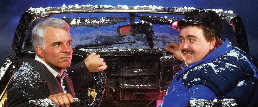 "Steve Martin and John Candy head home for the holidays in ""Planes, Trains and Automobiles."""
