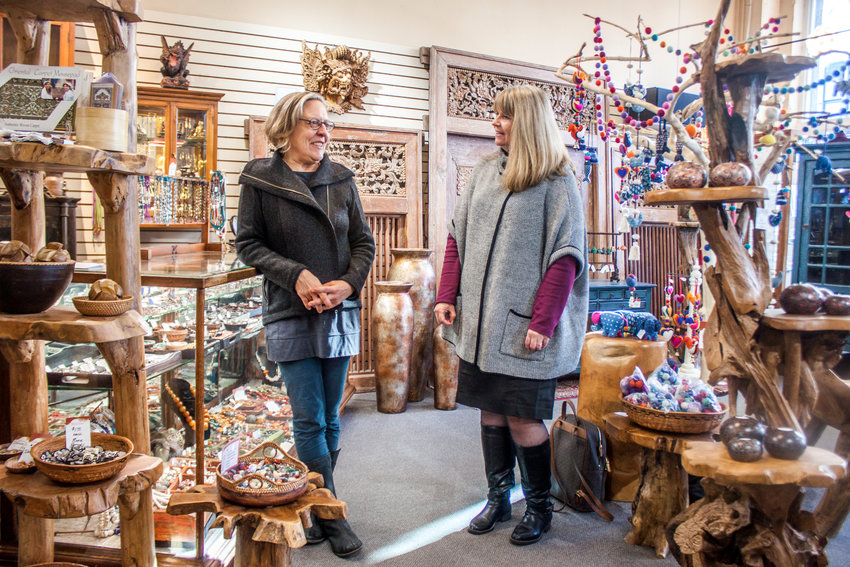 Jennefer Wood (left) owner of Maestrale Imports, shares with Kerrie Hurd, Seattle district director of the U.S. Small Business Administration, how she bought her building with an SBA loan in 2011.