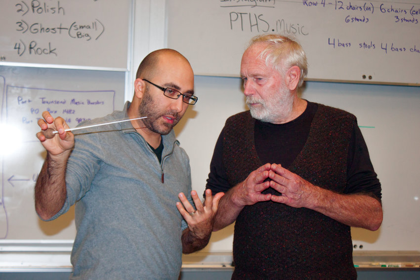 """Port Townsend Symphony Orchestra Conductor Tigran Arakelyan (left) instructs guest-conductor Phil Andrus, host of """"Tossed Salad"""" on KPTZ 91.9 FM, on how to conduct the Radetzky March by Strauss."""