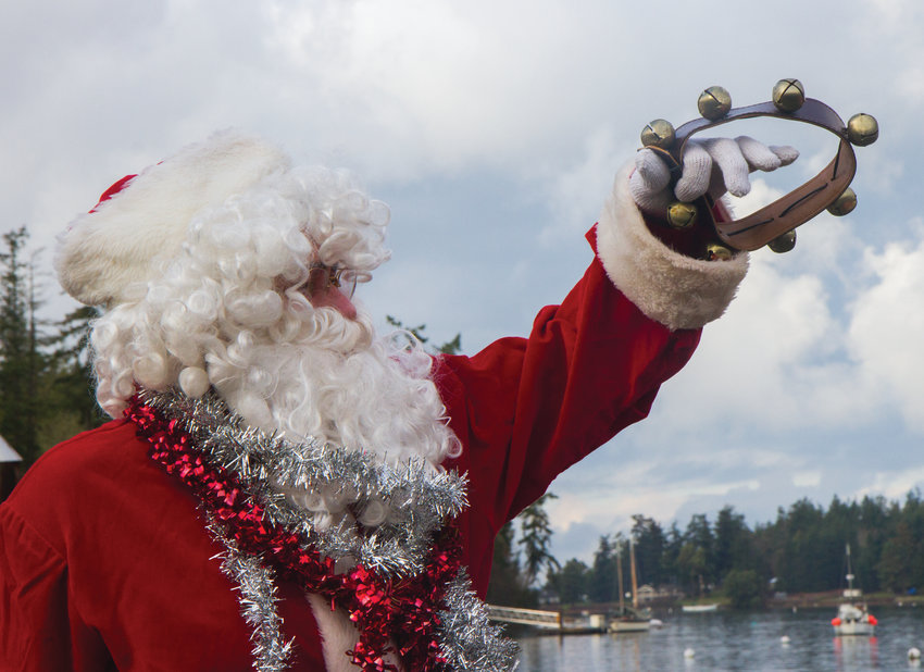 Santa arrives by boat to the Nordland General Store.