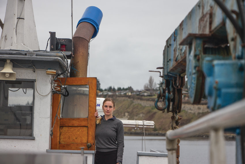 Rebecca Argo at the wheelhouse of the 76-foot scow Sunnyvale, a salmon tender, which she captained last summer. Argo's salmon tender operates out of Port Townsend's Boat Haven, serving southeast Alaska. Her experiences as skipper brought her to Rome in November, where she spoke at the United Nations sustainable fisheries conference.