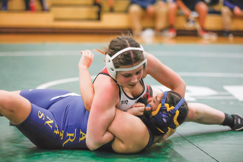 Chloe Lampert ties her Forks Spartan opponent's arms in a bow before pinning down the shoulders and walking away with the win. PTHS girls participated in the Wrestle Rama Jamboree Dec. 4.
