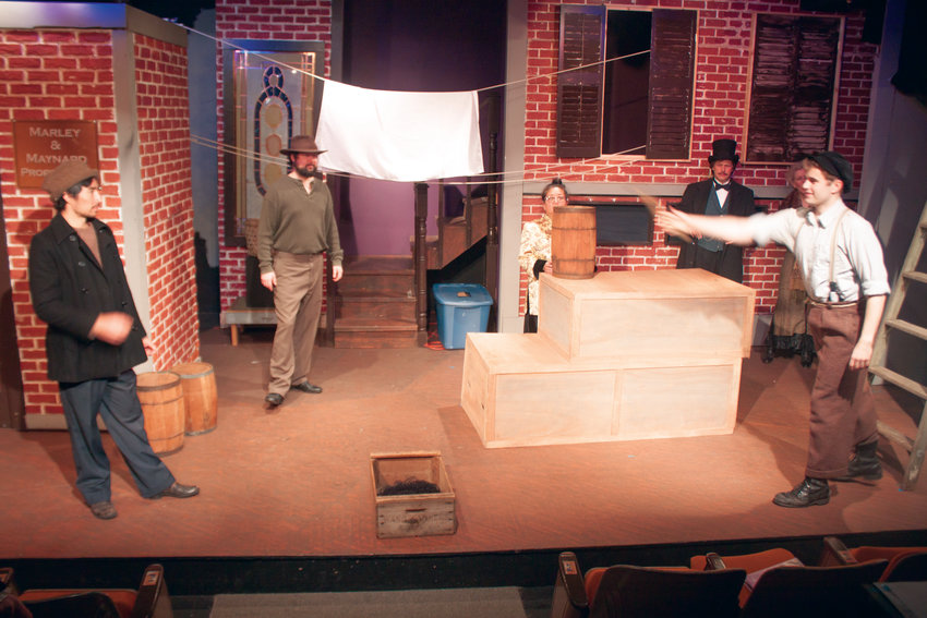 """Brendan Chambers (second from left) looks on as the Key City Public Theatre players rehearse their """"shenanigans"""" for this year's holiday performances in the playhouse."""