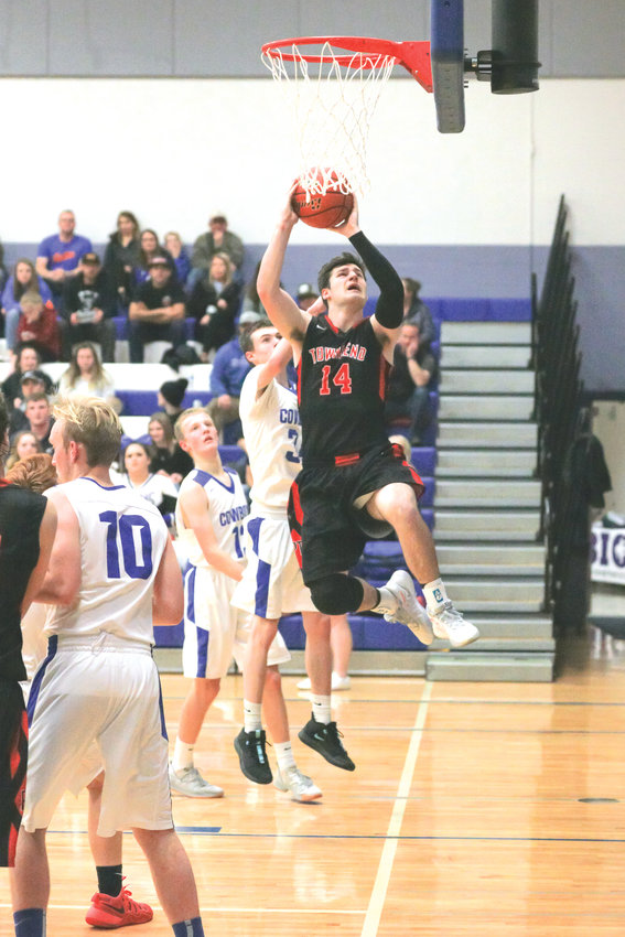 In a deft display of grace and agility, Redhawks guard, Noa Apker-Montoya chooses his lane, takes a step, then floats to the basket as if summoned by a higher power.