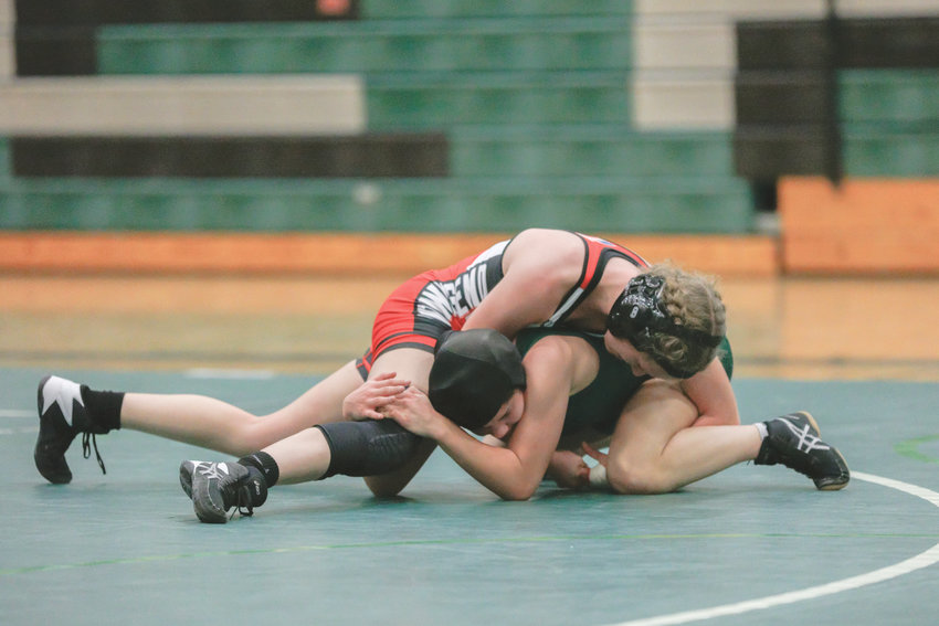 Savanna Hoffmann squeezes her arms to close the cradle on her opponent.