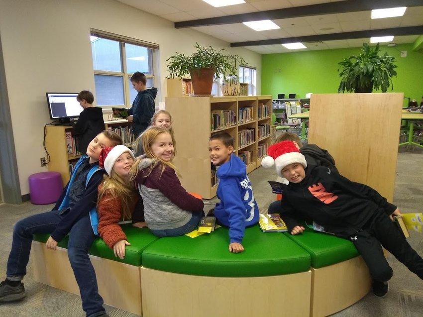 Chimacum Elementary fourth graders (from left) Landon Bergen, Ariana Beringer, Kaitlyn Nagy, Braydon Rollness and Kennon Hendricks in the new renovated library space.