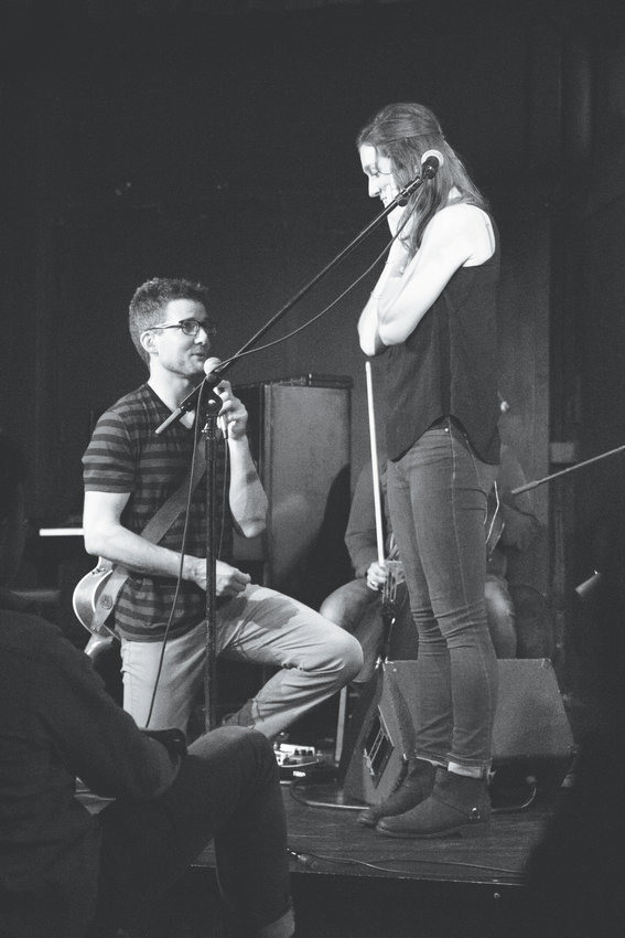 Jimmy Stewart proposes to Aili Emilia during their sold-out show at the Bryant Lake Bowl Theater in Minneapolis on Sept. 26, 2019.