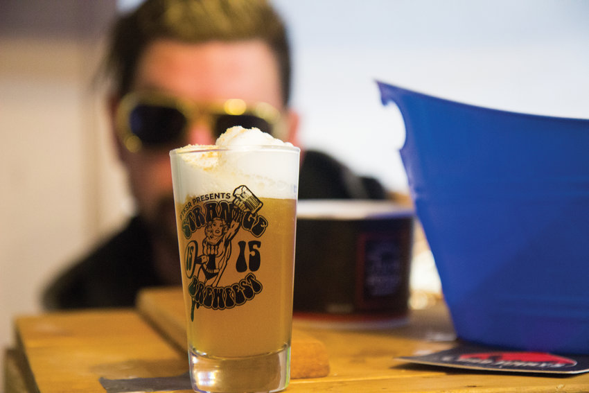 Greg Gramenz served up a Strawberry Mango Cheesecake Hefeweizen, with a graham cracker sprinkle, created by Bad Jimmy's Brewing, at last year's Strange Brewfest.