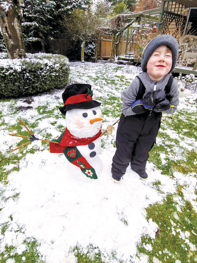 "After a disappointing Seahawks game, young Easton Benedict heads outside for what his grandpa Mark McCready called ""snow therapy."" Around 2 inches fell in Port Townsend the evening of Jan. 12, just enough to build a small snowman."