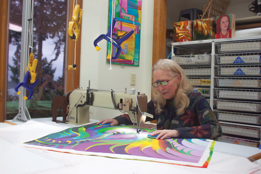 Although much of her quilt design work involves her computer, Port Townsend quilt artist Caryl Bryer Fallert-Gentry still relishes the tactile work of sewing the fabric by hand, albeit on her sewing machine.