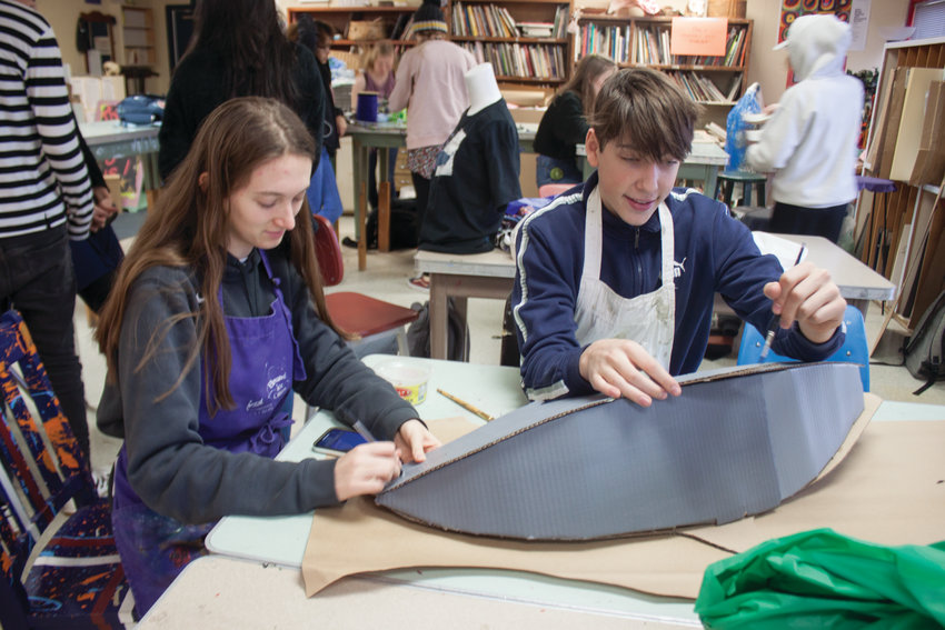 Port Townsend High School junior Riley Johnson and senior Sam Boatman create a wearable art headpiece resembling a rare species of porpoise known as the vaquita.