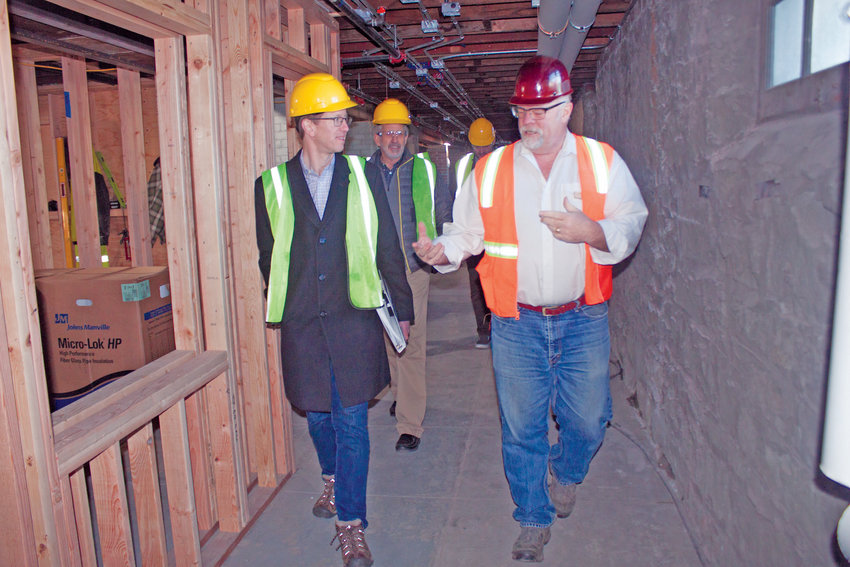 U.S. Rep. Derek Kilmer, of Washington state's 6th congressional district, is guided by David Opp-Beckman, director of facilities and capital projects for the Fort Worden Public Development Authority, through Building 305, the future home of KPTZ 91.9 FM at Fort Worden's Makers Square, with Fort Worden PDA Executive Director David Robison following closely behind. The hallways in Buildings 305, 308 and 324 will  showcase artwork and exhibits that tell the history of Fort Worden.