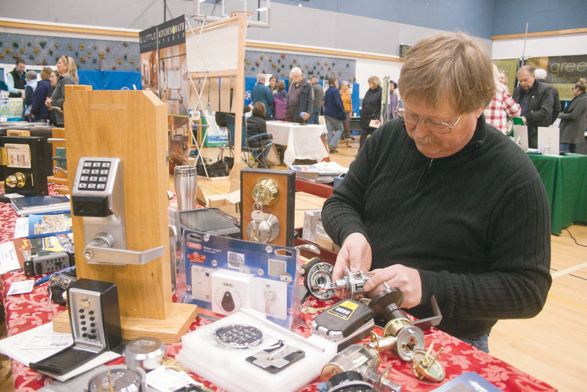Terry Fogerson, of Terry's lOck and Safe, disassembles locks at the Jefferson County Home Show.