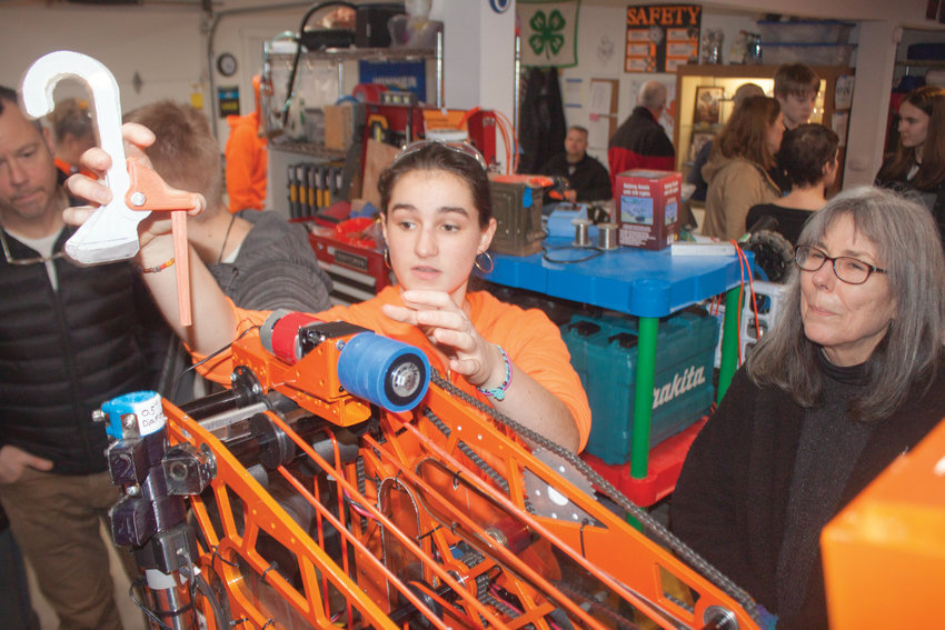 """Port Townsend FIRST Robotics Competition """"Roboctopi"""" President Olivia Morningstar shows off the 3D-printed grappling hook that her team's 125-pound robot is designed to use to lift itself."""