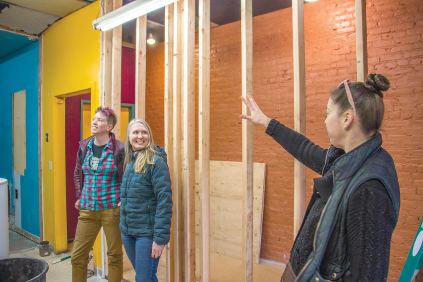 From left Eileen Skidmore, Kim Hendricks and Tina Fink-Sezgun survey progress on the remodel of the Owl Sprit Cafe kitchen. The changes will see the size of the kitchen and dining room expand to use their space more effectively. Leader photo by Carmen Jaramillo