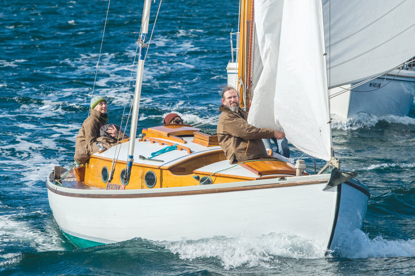 """Leah Kefgen with her """"Pacific Norse Vest""""-clad crew on Sean Rankins' Danish spidsgatter, Cito. The crew, which included students at the Northwest School of Wooden Boat Building finished first in the cruising class of the 2020 Shipwrights' Regatta. The crew also won the award for racing the oldest wooden boat with """"excellent restoration."""""""