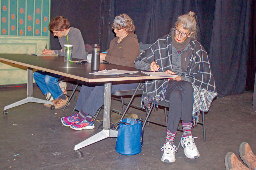 From left, local playwrights Doug Given, Diana Carson-Walker and D.D. Wigley complete their final writing exercise during Los Angeles-based stage and screenwriter A.P. Andrews' playwriting intensive at the Key City Playhouse in Port Townsend on Sunday, March 15.