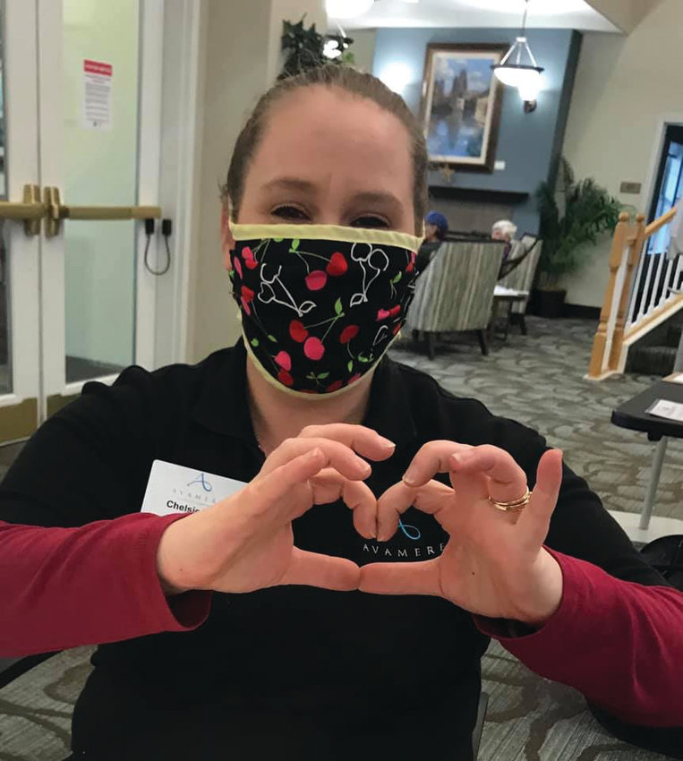 Chelsea Ortiz, a caregiver at Avamere Port Townsend, wears a mask made by one of the many members of Port Townsend's Face Mask Challenge group.