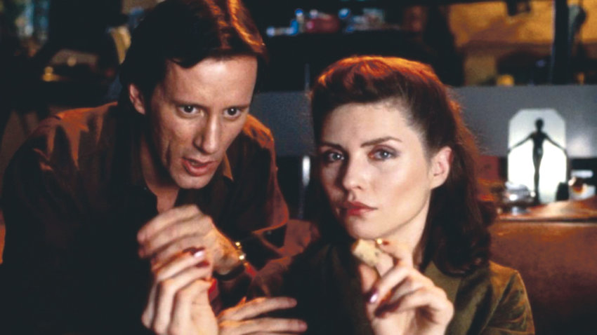 "James Woods and Debbie Harry invite you to try a few things in David Cronenberg's ""Videodrome."""