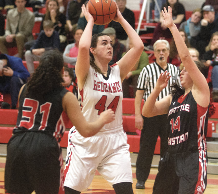 Isabel Hammett prepares to shoot a basket in a Feb. 2019 varsity basketball game against Seattle Christian. Leader file photo